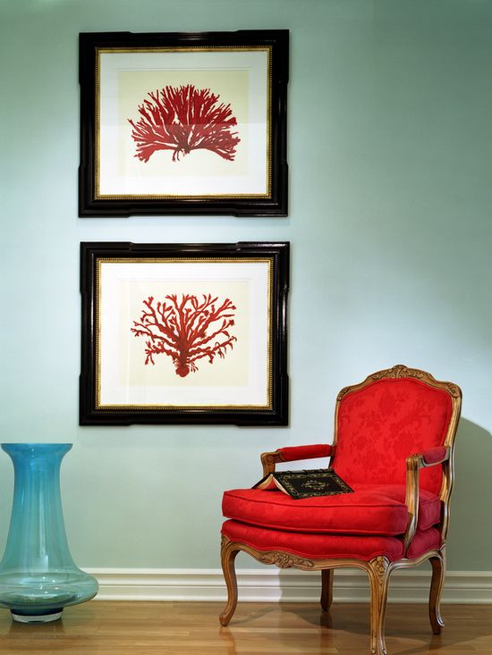 Soft blue walls let this tangerine artwork and upholstered antique chair make a bold statement. (www.hgtv.com/...)