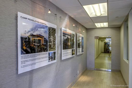 Custom project displays show off our clients impressive mechanical contracting work#office #lobby #interior design #san diego office design #artwork