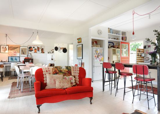 Home of Australian artist Paula Mills.  Love the red couch.