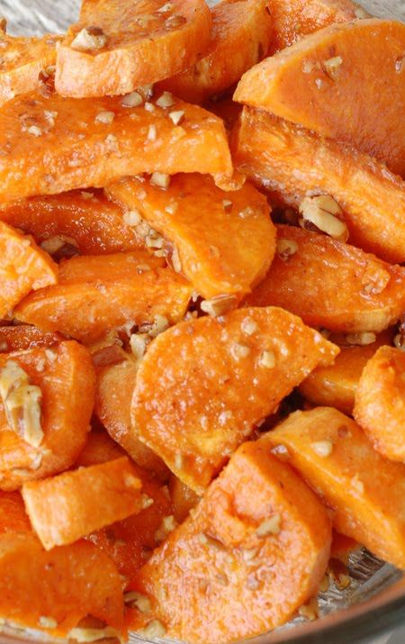 Sweet potatoes tossed in olive oil & coarse salt then drizzled with butter, brown sugar, pecans, cayenne & baked another 10 min. to carmelize sugar