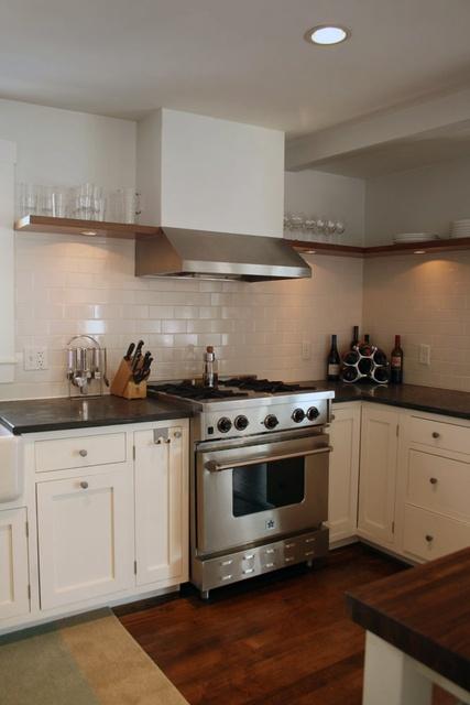 single shelf wrapping the kitchen, undermount lights