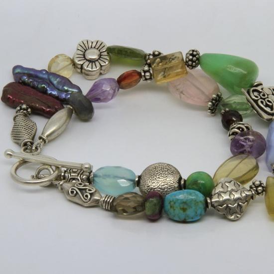 Mixed gemstone bracelet, crysophrase, rose quartz, citrine, amethyst, turquoise, calcedony. €120,00, via Etsy. Pebbles and Chance SHOP