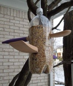 bird feeder from 2 Liter bottle and wooden spoons
