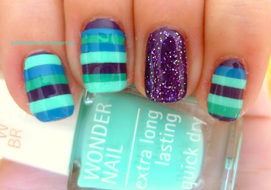 One of the Top trending Nail Art Designs is having an off set nail color on any one nail. (Turquoise, aqua, jade stripes with purple accent nails nail art design)