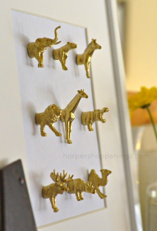 gold painted / plastic toy animals / mounted