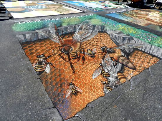 "Ventura, California-based 3D chalk artist Tracy Lee Stum is well-known for her brilliant ongoing series of ""interactive 3D chalk art street paintings."" She began street painting in 1998 and is still, to this day, going strong."