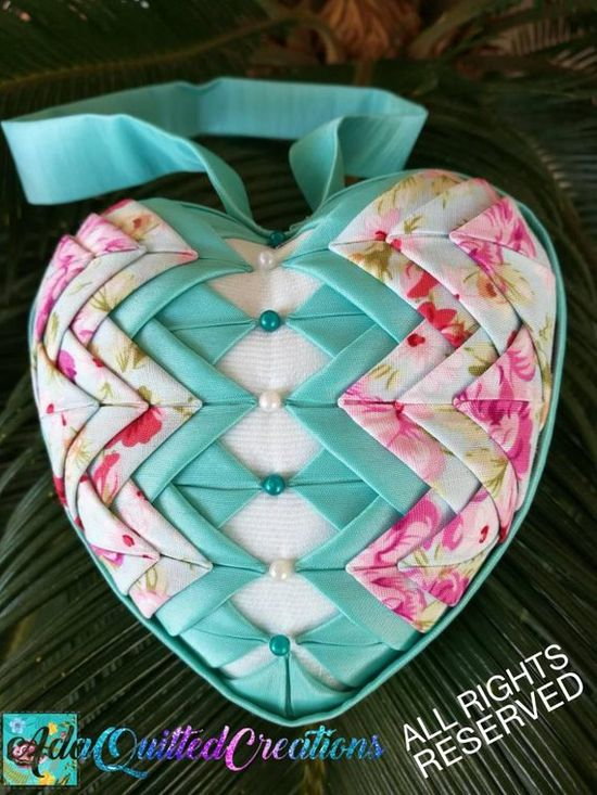 Looking for beautiful shabby chic nursery decor? You can decorate your nursery or home with this beautiful folded fabric heart ornament. It comes in two variations: - Wonderful salmon / peach satin, shabby chic floral fabric and off white laced interior - Teal taffeta, shabby chic