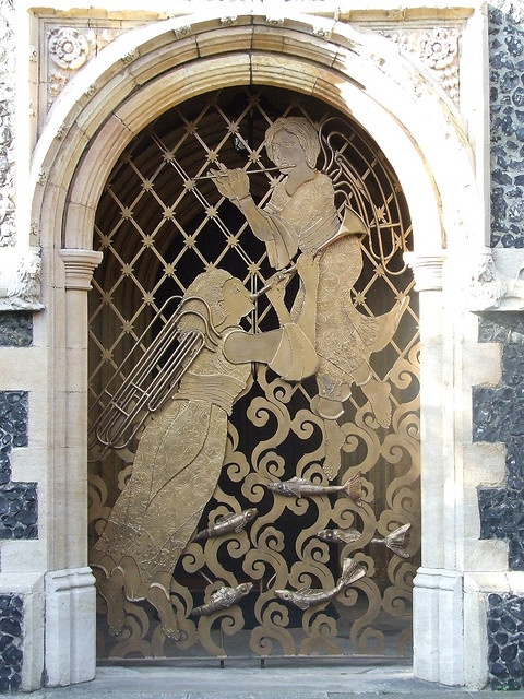Doorway to a church in Ipswich, England, with an amazing piece of metal work