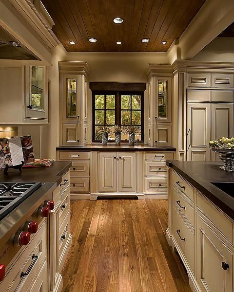 Love! cream cabinets, dark counters and knobs, oak floors and the wood ceiling.