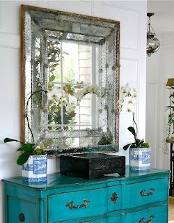 Turquoise chest and stunning mirror
