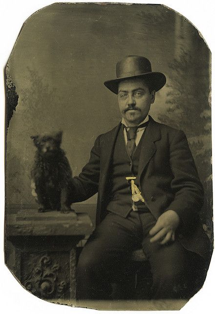 A cheery chap and his dog .... (i find this to be odd and delightful at the same time:)).