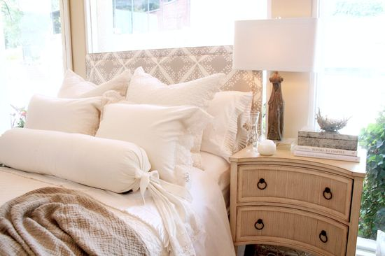 Love the white and cream bedding with lace and pleats.  Soft and natural.