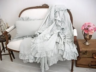 Luscious, ruffled throw blanket on french antique setee
