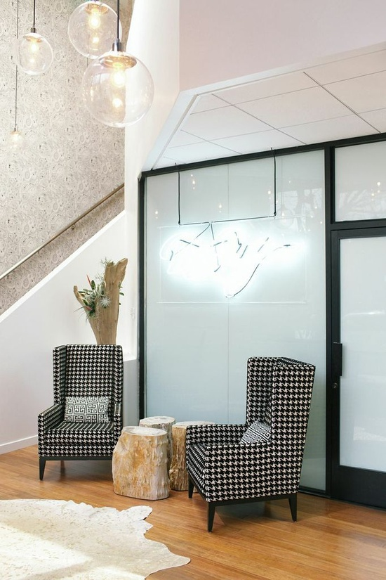 Alle Fister of Bollare Communications // office space // houndstooth chairs // glass fixtures // tree stump // photography by @Kimberly Genevieve