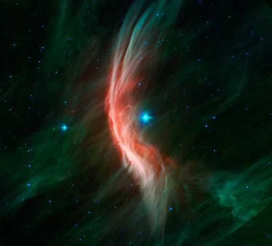 The giant star Zeta Ophiuchi, a young, large and hot star located around 370 light-years away, is having a shocking effect on the surrounding dust clouds in this infrared image from NASAs Spitzer Space Telescope.