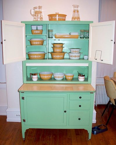 Lovely collection of gold Pyrex on vintage teal hutch..