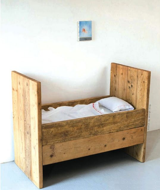Love this little wooden bed. #FeatherYourNest