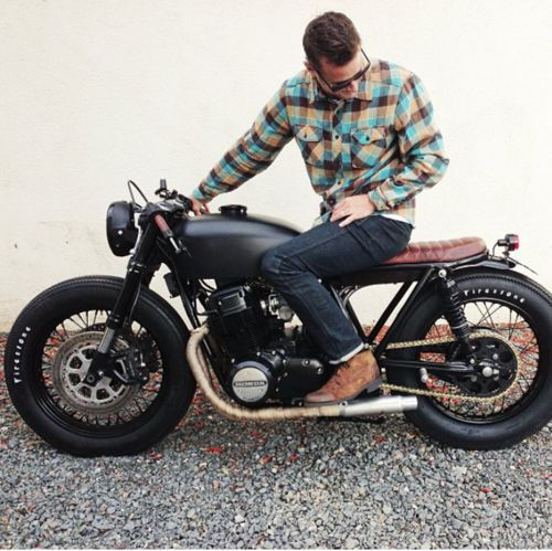 Matte black Honda CB750 SOHC custom with brown leather custom seat