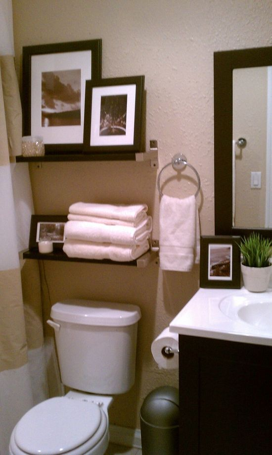 Small bathroom- decorative storage above toulet #bathroom
