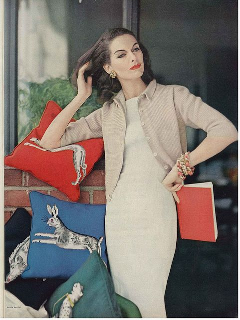 Gorgeous as the make-up is and chic as her simple, clean lined outfit is, it's the darling animal adorned pillows that make this image a fabulous one in my eyes. #pillows #vintage #fashion #clothes #1950s