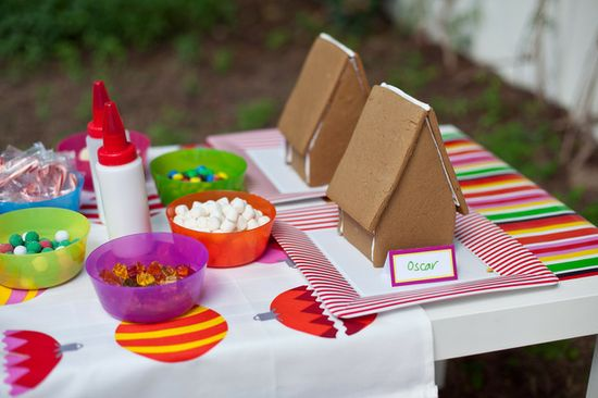 Decorating gingerbread houses at a IKEA Christmas party!  See more party ideas at CatchMyParty.com!  #partyideas #christmas