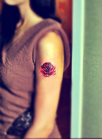 rose tattoo on the arm