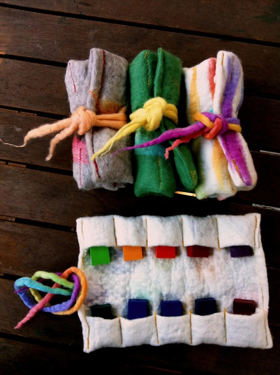 Hand felted handmade wool felt Crayon Roll with 10 Stockmar beeswax crayons green feather felted rope tie.