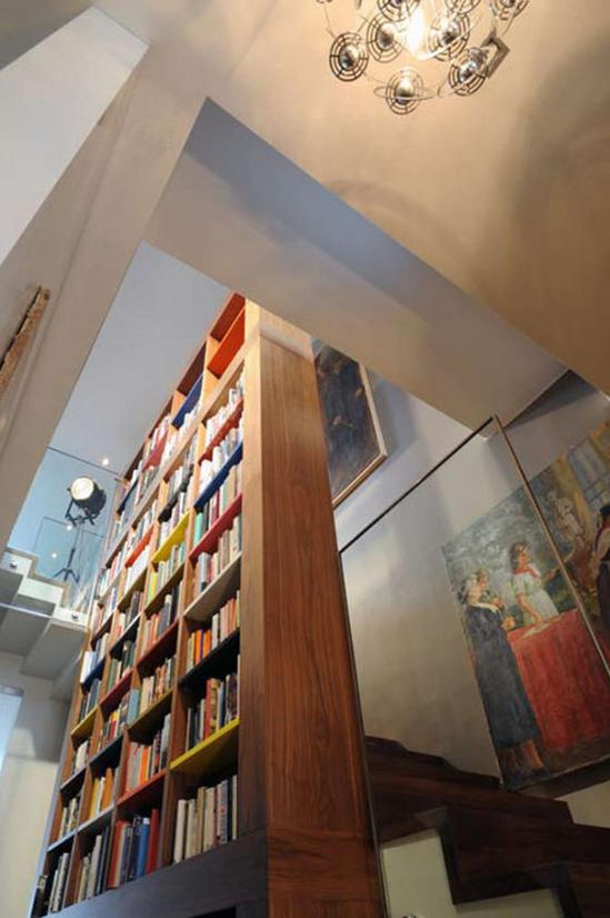 Giant Bookcase in Stairwell. Unique and practical, Precious McBane