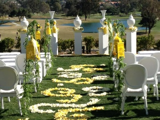 Wedding shoot used yellow Casablanca Lanterns as aisle decor