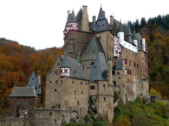 Burg Eltz Castle. Germany. By izik  Burg Eltz is another example of outstanding German castles. This amazing medieval construction in southwest Germany is still owned by a branch of the same family that resided there over 800 years ago. The present owner of the castle is Dr. Karl Graf von und zu Eltz who represents the 33rd generation of the House of Eltz.