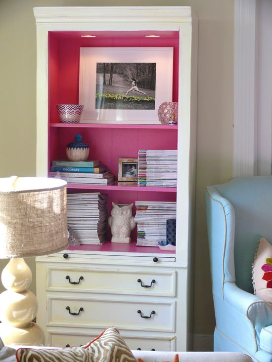 How to add a pop of color? Simply paint the inside of a bookcase!