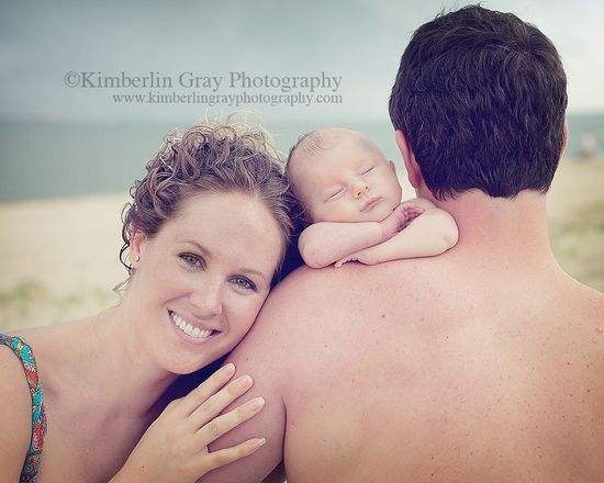 Beautiful newborn with family at the beach.