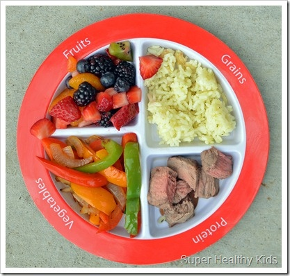 #myplate dinner: fruit salad, sauteed peppers, rice, and steak.