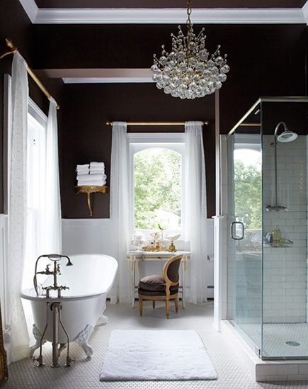 Loving this elegant bathroom. The light fixture and claw foot tub are to die for.