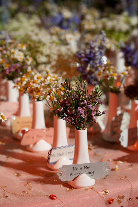 Another shot of the little vases used for place cards or escort cards. So cute! Photography by gulnarastudio.com