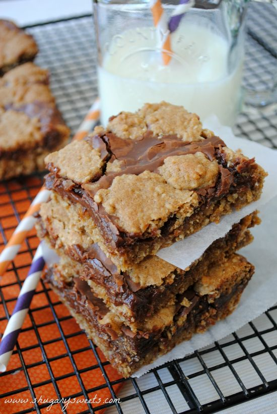 Triple Chip Revel Bars- oatmeal cookie bars filled with butterscotch, dark chocolate and milk chocolate chips! #cookiebars #dessert www.shugarysweets...