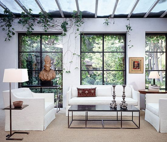 Love the sofa styles and the windows!