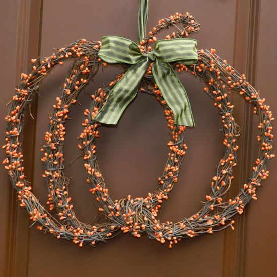 Pumpkin Wreath. Just stagger 3 grapevine wreaths into pumpkin shape and wrap in berries. So cute!!