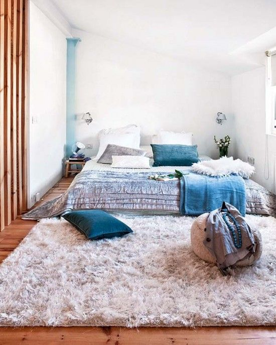 Small bedroom with white rug