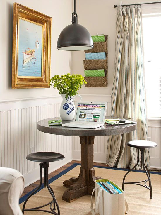 Dine or WorkWith the help of wall-mount file pockets and a portable file box, a small table in a corner of the living room easily goes from dining to an impromptu office. Swivel stools tuck neatly under the table when not in use, saving space in the small quarters.
