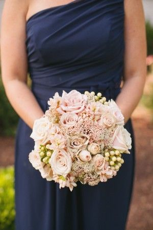 Blush bouquet, shows white hypericum, and roses
