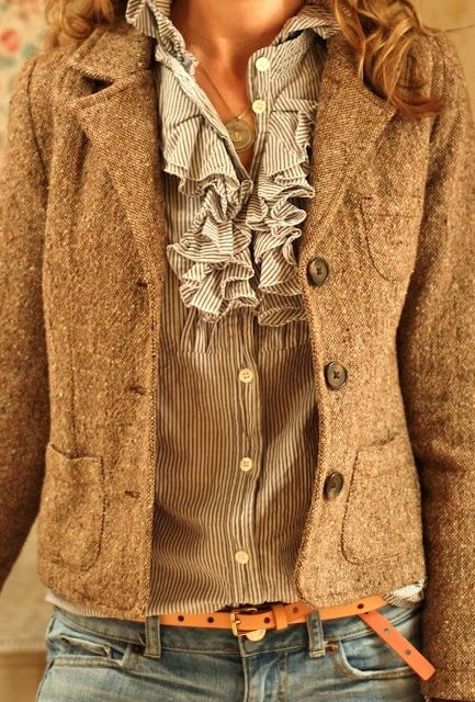 Tweed jacket, ruffled blouse, and washed-out blue jeans.  Super cute