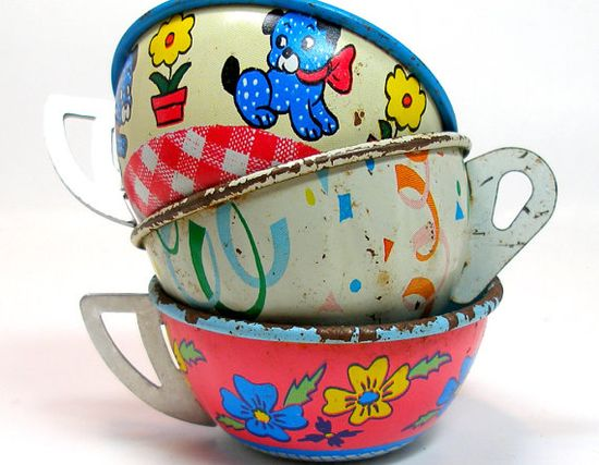 Tin Toy Tea Cups & Saucers, Set of 6 with cupcake, puppy and flowers via Etsy.