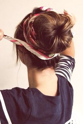 Wrap a head scarf around a bun — Tie your hair into a ponytail and tease one-in