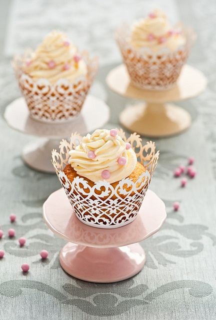Such a intricate, wonderfully pretty liners on these yummy cupcakes. #cupcakes #food #dessert #food #liner #wrappers #stand #cake #pink #wedding #birthday
