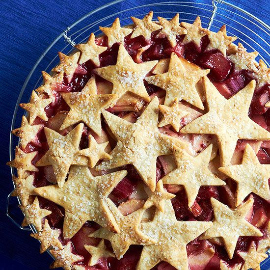 This Apple, Rhubarb, and Raspberry Pie with Almond Star Crust is sure to stand out at your 4th of July celebration! More festive 4th of July desserts:  www.bhg.com/...