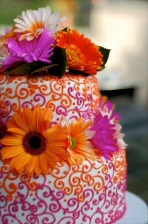 orange and pink wedding cake w/flowers