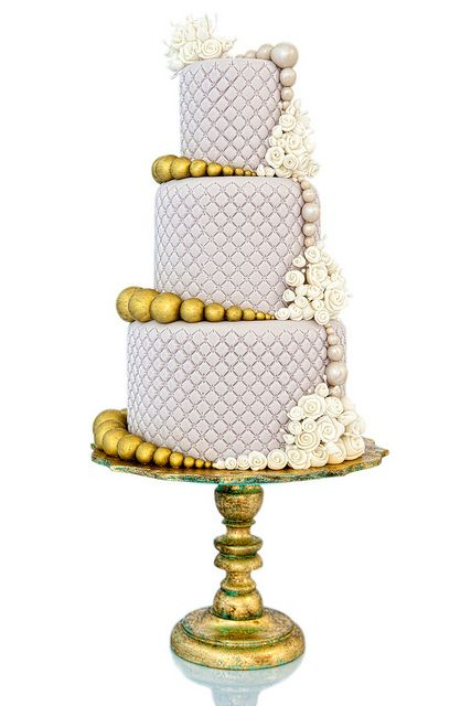 Purple and gold wedding cake.