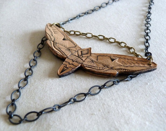 Handmade tattooed leather Moth necklace by Punctured Artefact on Etsy - very cool!