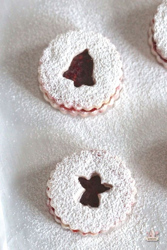 Raspberry Linzer Cookies - Raspberry Dough sandwiched with raspberry jam and dusted with powdered sugar. Perfect dough for decorating cookies with too!
